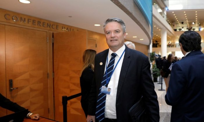 Australian Finance Minister Mathias Cormann arrives at G-20 plenary during the IMF/World Bank spring meeting in Washington, U.S., April 20, 2018. Yuri Gripas/Reuters