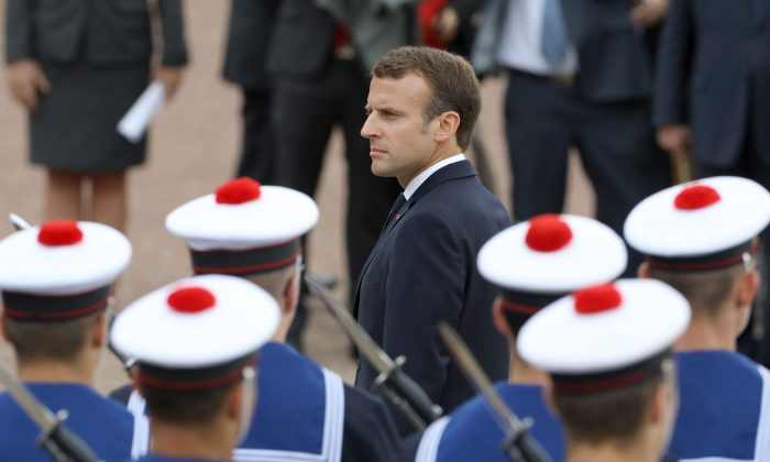 French President Emmanuel Macron reviews a troop of French navy soldiers on June 18, 2018 at the Mont Valerien national memorial in Suresnes, outside Paris. (Ludovic Marin/AFP/Getty Images)