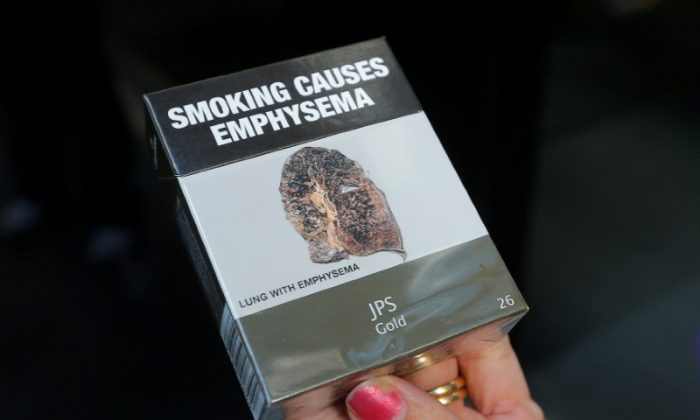 A photo illustration shows restrictive tobacco packaging on cigarettes outside a Sydney office building in Australia, May 5, 2017. (Reuters/Jason Reed)