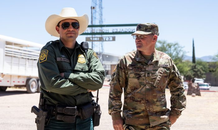 Sgt. First Class Thomas Evitts (R) and Border Patrol Agent Garcia at the Tucson Sector Border Patrol headquarters in Nogales, Ariz., on May 23, 2018. (Samira Bouaou/The Epoch Times)