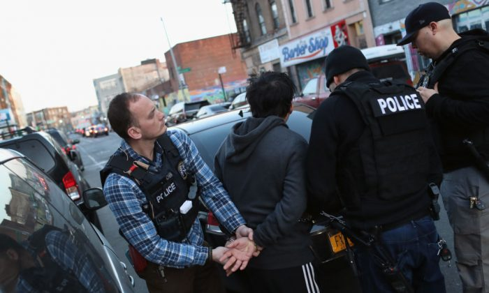 U.S. Immigration and Customs Enforcement (ICE), officers arrest an undocumented Mexican immigrant during a raid in the Bushwick neighborhood of Brooklyn on April 11, 2018 in New York City. (John Moore/Getty Images)