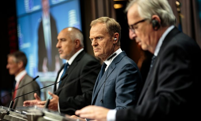 Bulgaria's Prime Minister Boyko Borisov, European Council President Donald Tusk and President of the European Commission Jean-Claude Juncker give a joint press conference on the final day of the European Council leaders' summit on June 29, 2018 in Brussels, Belgium. (Jack Taylor/Getty Images)