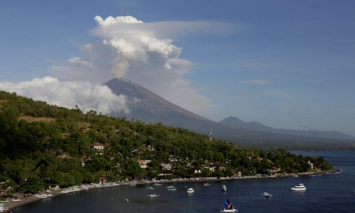 Mount Agung volcano can be seen erupting  from Amed in Karangasem Regency, Bali, Indonesia on June 29, 2018. (Reuters/Johannes P. Christo)