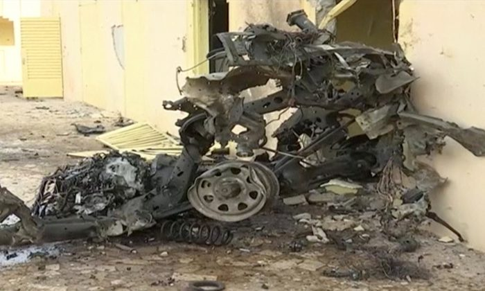 A still image taken from a video shot on June 29, 2018, shows the wreckage of a vehicle inside African military taskforce, G5 sahel headquarters, in the town of Sevare, Mali. (Le Sahelien/Handout via Reuters TV)