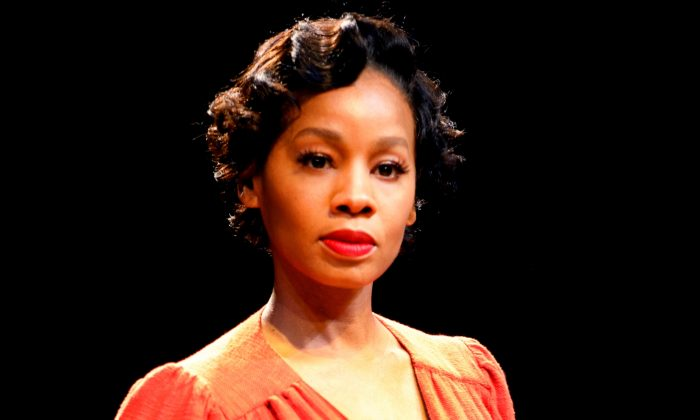 "Anika Noni Rose makes a makes a stunning Carmen Jones, in the musical based on Georges Bizet's opera ""Carmen."" (Joan Marcus)"