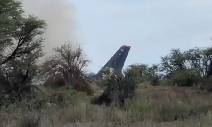 Smoke billows above an Aeromexico-operated Embraer passenger jet that crashed in Mexico's northern state of Durango, July 31, 2018, in this still image taken from a video obtained from social media. (Contacto Hoy/via Reuters)