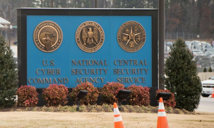 A sign for the National Security Agency (NSA), US Cyber Command and Central Security Service, is seen near the visitor's entrance to the headquarters of the National Security Agency (NSA) at the entrance in Fort Meade, Maryland, February 14, 2018. (SAUL LOEB/AFP/Getty Images)