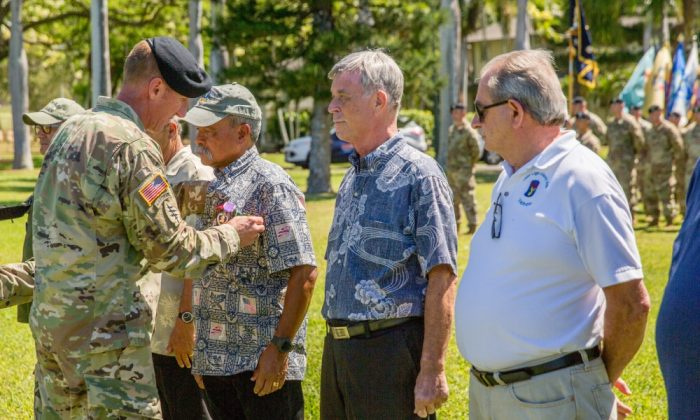 U.S. Army Col. Sean Berg, 196th Infantry Brigade commander, pins medals onto Allen Hoe during 196th Infantry Brigade Vietnam Veterans' Recognition Ceremony at Fort Shafter, Hawaii on June 29, 2018. (U.S. Army photo by Jonathan Steffen)