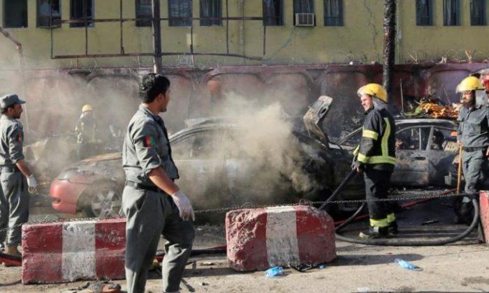 Afghan policemen inspect the site of a blast in Jalalabad city, Afghanistan, July 1, 2018. REUTERS/Parwiz