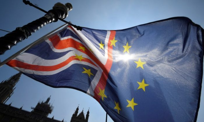 A combined United Kingdom and European Union flag flies outside the Palace of Westminster in London, Britain, June 28, 2018. (Reuters/Toby Melville)