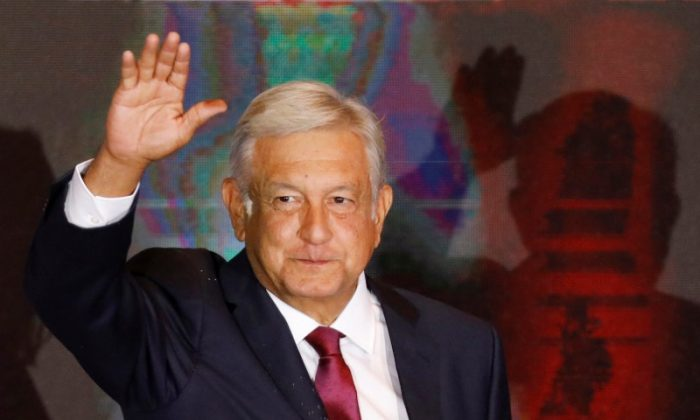 Presidential candidate Andres Manuel Lopez Obrador waves as he addresses supporters after polls closed in the presidential election, in Mexico City, Mexico, on July 1, 2018. (REUTERS/Carlos Jasso)