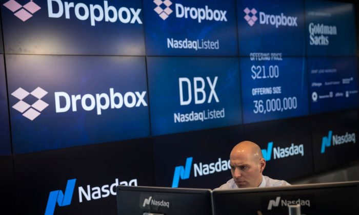 Jay Heller, Head of IPO Execution at Nasdaq, monitors a computer screen as trading starts on Dropbox's initial public offering at Nasdaq MarketSite, in New York City on March 23, 2018. (Drew Angerer/Getty Images)