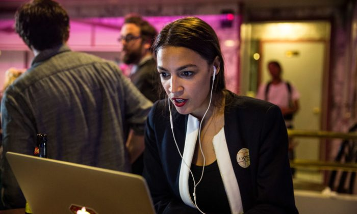 Progressive challenger Alexandria Ocasio-Cortez celebrartes  at a victory party in the Bronx after upsetting incumbent Democratic Representative Joseph Crowly in New York City on June 26, 2018.  (Scott Heins/Getty Images)