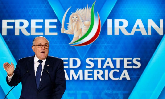 Rudy Giuliani, former Mayor of New York City, delivers his speech as he attends the National Council of Resistance of Iran (NCRI), meeting in Villepinte, near Paris, France, June 30, 2018.  (Reuters/Regis Duvignau)