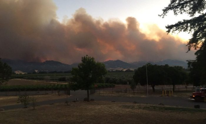 Smoke rises in distance from County Fire near County Road 63 and Highway 16 in Rumsey Canyon in this #CountyFire image on social media in Brooks, California, on July 2, 2018. (REUTERS)