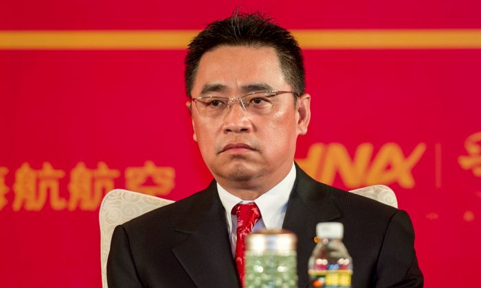Wang Jian, Co-Chairman of HNA Group attends a meeting marking the 20th anniversary of company's founding in Haikou, Hainan province, China, April 28, 2013. (REUTERS/Stringer, File Photo)