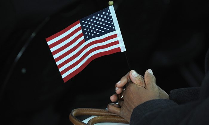 Person hold a American flag during a Naturalization Ceremony in New York City. (Brad Barket/Getty Images)
