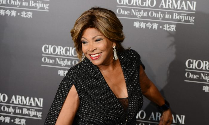 Tina Turner arriving on the red carpet for the fashion show by 77-year-old designer Giorgio Armani at the 798 art complex in Beijing on May 31, 2012. (MARK RALSTON/AFP/GettyImages)