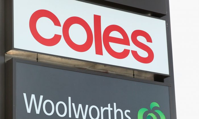 Coles and Woolworths signs are seen outside a shopping centre in Melbourne, Australia, on May 25, 2015.  (Quinn Rooney/Getty Images)