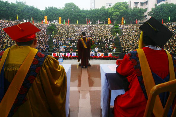 Bachelor graduates attend a graduation ceremony at the Chongqing University in Chongqing on June 22, 2007. (China Photos/Getty Images)
