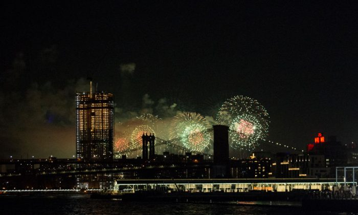 Fireworks are seen from the East River on the South Brooklyn route of a New York City ferry in the Manhattan borough of New York City on July 4, 2017. (Alex Wroblewski/Getty Images)