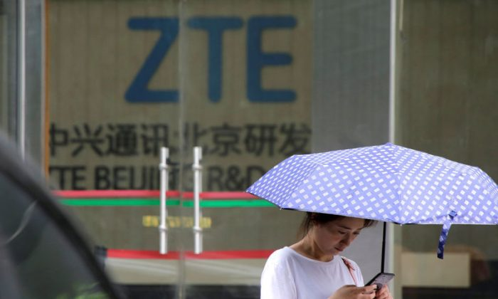 A woman stands outside a building of ZTE Beijing research and development center in Beijing, China June 13, 2018. (REUTERS/Jason Lee)