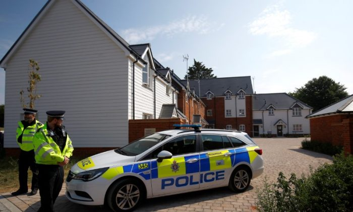 Police officers guard the entrance to a housing estate on Muggleton Road, after it was confirmed that two people had been poisoned with the nerve-agent novichok, in Amesbury, Britain, July 5, 2018. (Reuters/Henry Nicholls)
