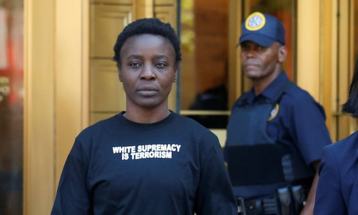 Patricia Okoumou walks out of federal court from her arraignment, a day after authorities say she scaled the stone pedestal of the Statue of Liberty, in Manhattan, New York, on July 5, 2018. (REUTERS/Shannon Stapleton)