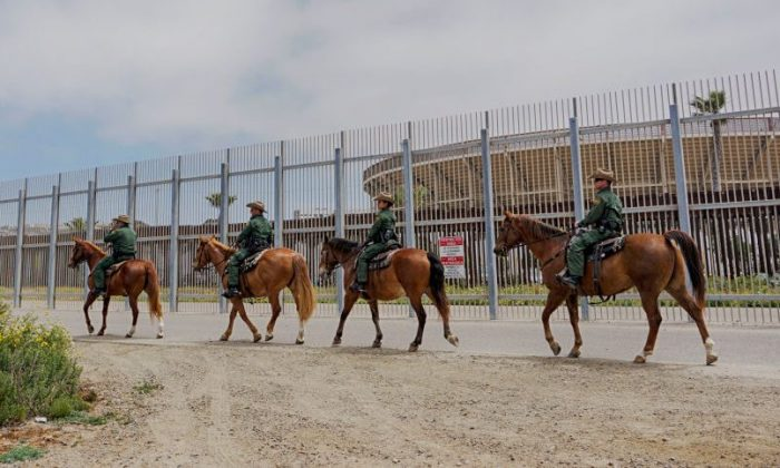 Border Patrol agents patrol the area near where Attorney General Jeff Sessions addresses the media during a press conference at Border Field State Park in San Ysidro on May 7, 2018. (Sandy Huffaker/Getty Images)