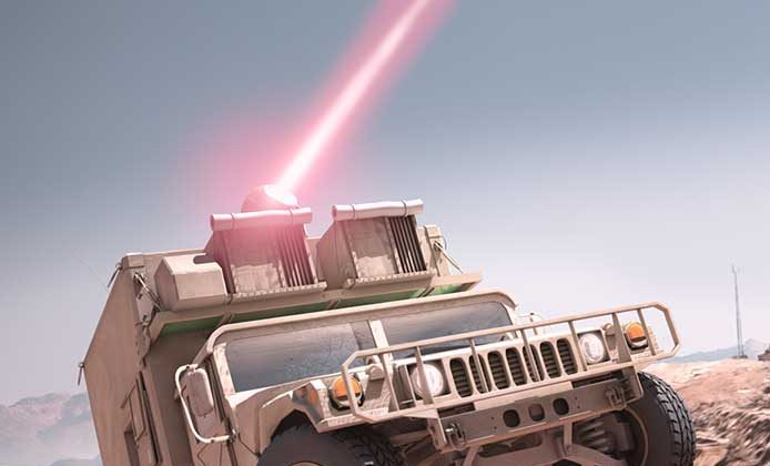 Raytheon is helping to develop a laser weapon for the U.S. Marines that is small and rugged enough to be mounted on a tactical ground vehicle, as shown in this illustration. (Raytheon)