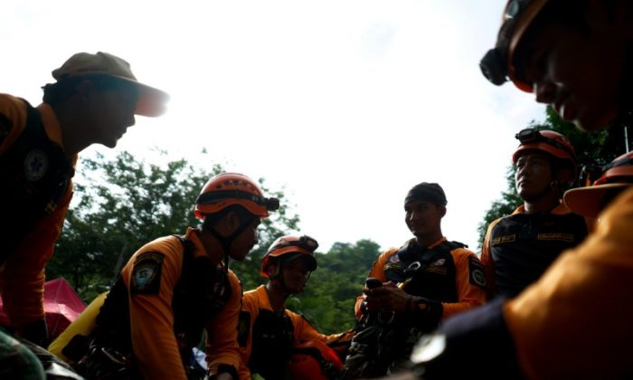 Rescue workers get ready to explore an area for shafts near the Tham Luang cave complex, where 12 boys and their soccer coach are trapped, in the northern province of Chiang Rai, Thailand, July 6, 2018. (Reuters/Athit Perawongmetha)