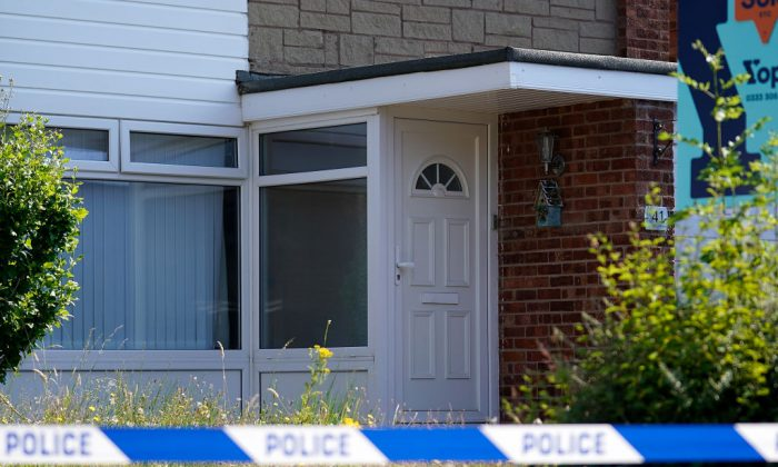 A police officer stands outside a house in Chester after a healthcare professional working was arrested on suspicion of murdering eight babies and attempting to kill six others, on July 4, 2018 in Chester, United Kingdom. She was released on bail on July 6. (Christopher Furlong/Getty Images)
