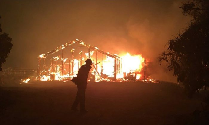 A wildfire burns a structure in Goleta, California, U.S., July 6, 2018 in this image obtained on social media. (Mike Eliason/Santa Barbara County Fire/via Reuters)