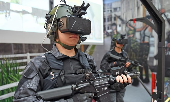 Armed military soldiers display the home made Shooting Simulation System during a press conference of the 2015 Taipei Aerospace and Defense Technology Exhibition at the World Trade Center in Taipei, Taiwan, on Aug. 12, 2015. (SAM YEH/AFP/Getty Images)