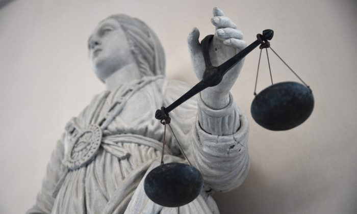 A statue depicting the goddess of Justice balancing the scales is seen at the Rennes courthouse in France on May 19, 2015. (Damien Meyer/AFP/Getty Images)