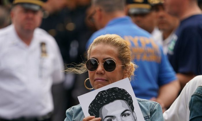 Members of the public gather outside the funeral for Lesandro Guzman-Feliz in the Bronx, New York, on June 27, 2018. (Don Emmert/AFP/Getty Images)