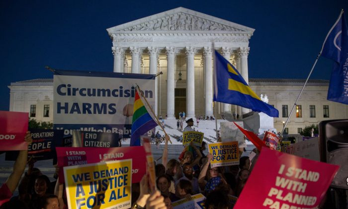 Protesters demonstrate in front of the U.S. Supreme Court on July 9, 2018, in Washington. President Donald Trump just announced his Supreme Court nominee Judge Brett Kavanaugh on Monday night. (Tasos Katopodis/Getty Images)