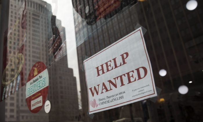 "A ""help wanted"" sign hangs on a window of a restaurant in Lower Manhattan, May 4, 2018 in New York City. (Drew Angerer/Getty Images)"