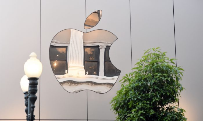 An Apple logo is seen on the outside of an Apple store in San Francisco, California on September, 22, 2017. (Josh Edelson/AFP/Getty Images)