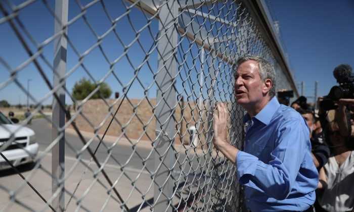 New York City Mayor Bill de Blasio stops at a gate after being told he could not cross through the gate to the tent facility setup at the Marcelino Serna Port of Entry as he joins with other mayors from the U.S. Conference of Mayors on the border to protest President Donald Trump's immigration policy on June 21, 2018, in Fabens, Texas.  (Joe Raedle/Getty Images)