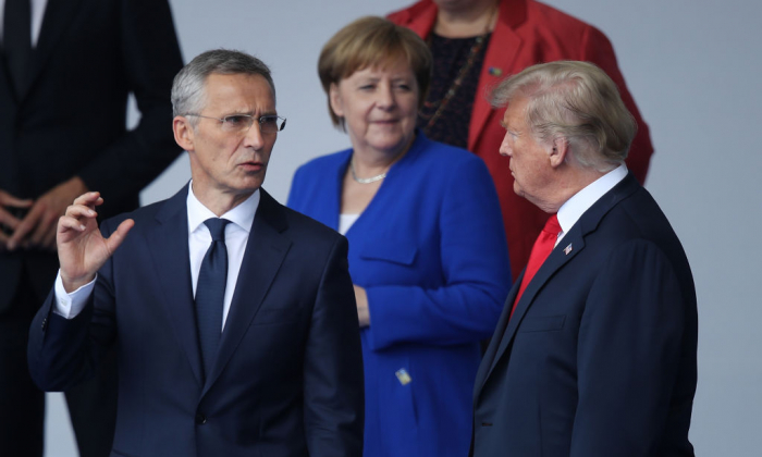 NATO Secretary General Jens Stoltenberg (L), German Chancellor Angela Merkel and President Donald Trump attend the opening ceremony at the 2018 NATO Summit at NATO headquarters on July 11, 2018 in Brussels, Belgium. (Sean Gallup/Getty Images)