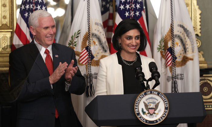 Seema Verma (R) speaks during a swearing-in ceremony, officiated by U.S. Vice President Mike Pence (L), in the Vice President's ceremonial office at Eisenhower Executive Building March 14, 2017 in Washington, DC. Verma is the administrator of the Centers for Medicare and Medicaid Services, which has proposed a rule change that would bar states from deducing union dues from Medicaid payments to home health care workers.  (Alex Wong/Getty Images)