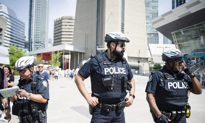 Police are seen in Toronto, on Thursday, July 12, 2018. (Christopher Katsarov/The Canadian Press).