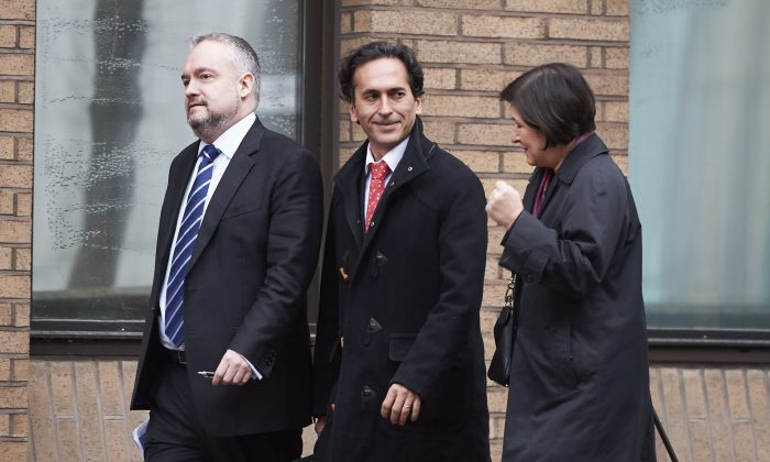 Former employee of Barclays bank, Philippe Moryoussef (C), arrives at Southwark Crown Court in London on Jan. 13, 2016. (Niklas Halle'n/AFP/Getty Images)