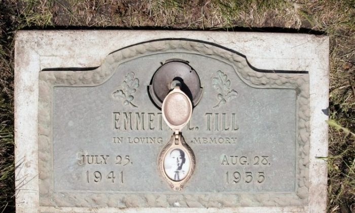 A plaque marks the gravesite of Emmett Till at Burr Oak Cemetery May 4, 2005, in Aslip, Ill. (Scott Olson/Getty Images)