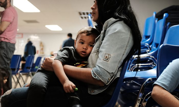 A woman who sits with her son at the Catholic Charities Humanitarian Respite Center after recently crossing the U.S.–Mexico border in McAllen, Texas, on June 21, 2018. (Spencer Platt/Getty Images)