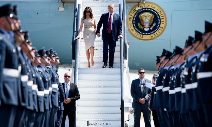 U.S. President Donald Trump and First Lady Melania Trump disembark Air Force One at Stansted Airport, north of London on July 12, 2018, as he begins his first visit to the UK as U.S. president. (Brendan Smialowski/AFP/Getty Images)