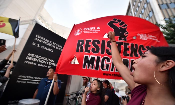Protestors chant outside the Metropolitan Detention Center where ICE (U.S.Immigration and Customs Enforcement) detainees are held in downtown Los Angeles, California on June 14, 2018 (ROBYN BECK/AFP/Getty Images)
