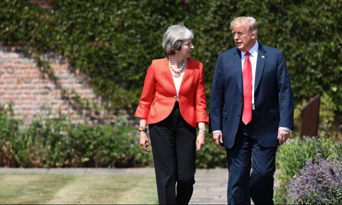 Prime Minister Theresa May walks with President Donald Trump at Chequers in Aylesbury, England,  on July 13, 2018. (Jack Taylor/Getty Images)
