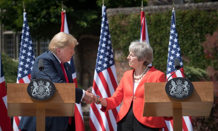 President Donald Trump and Britain's Prime Minister Theresa May shake hands during a press conference following their meeting at Chequers, the prime minister's country residence, on July 13, 2018. (STEFAN ROUSSEAU/AFP/Getty Images)
